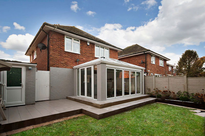 Contemporary Glass Extension With Patio In Wendover